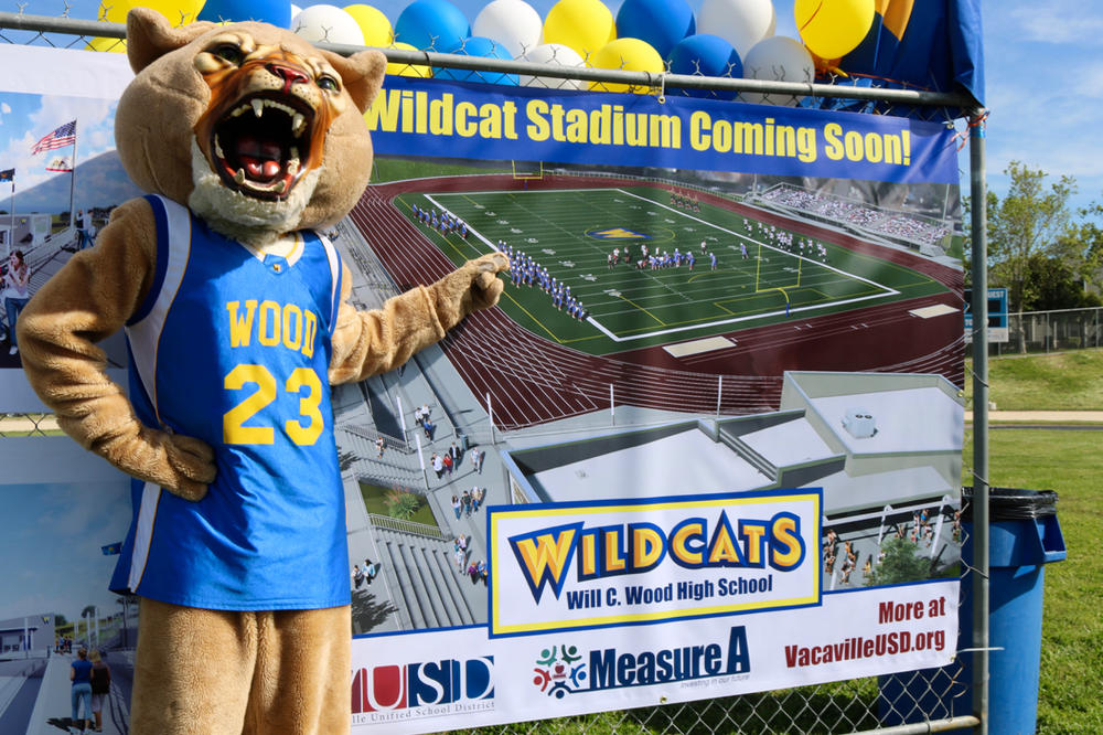 wildcat mason pointing to coming soon banner