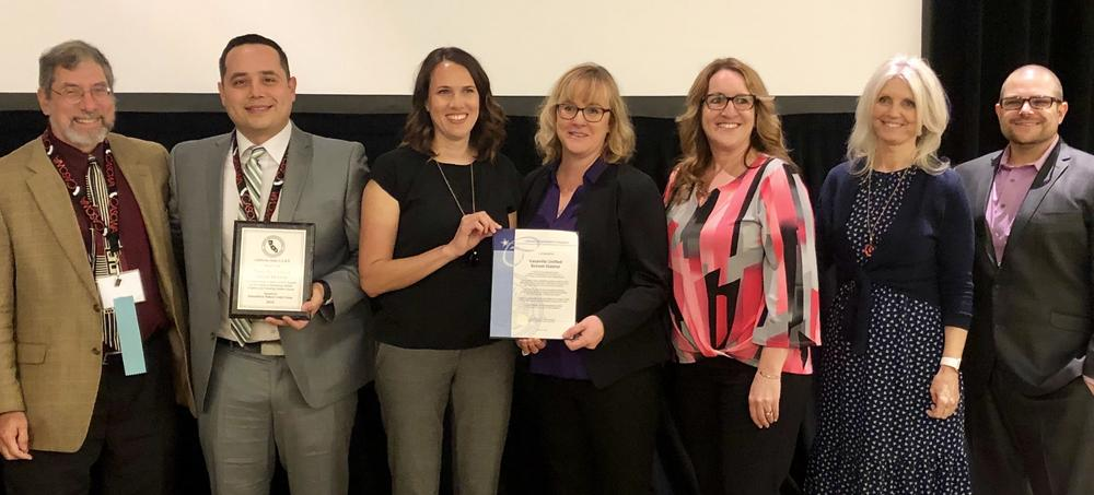 VUSD SARB team holding award from the State of California